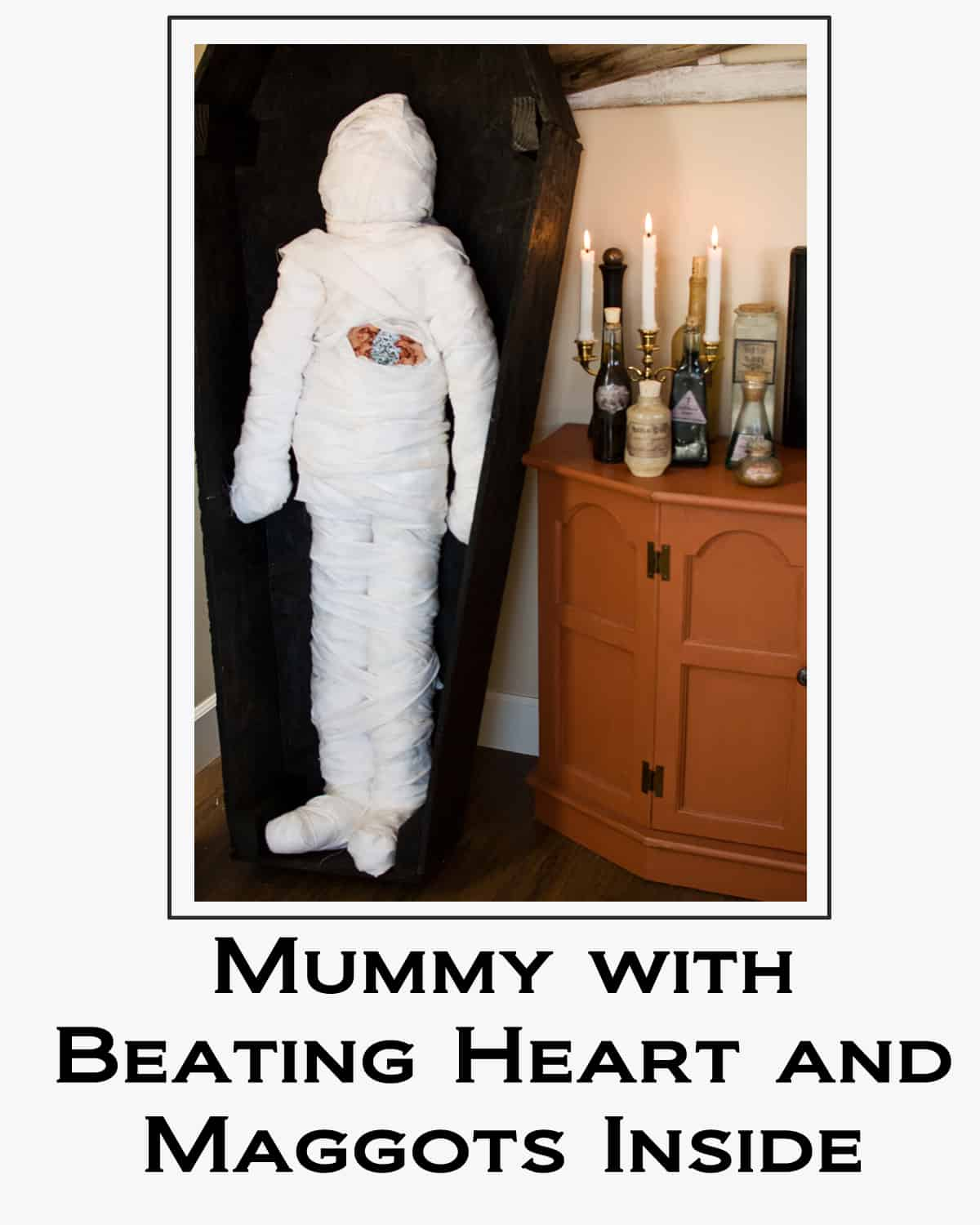 Mummy with Beating Heart and Maggots Inside button