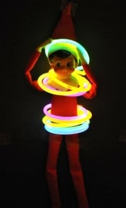 Elf covered in glow in the dark braclets