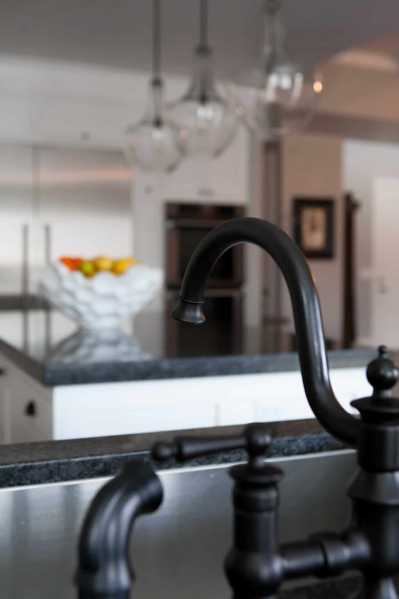 Choosing lighting, cabinet knobs and faucets for the kitchen can be a lot of stress! Come check out these great tips and tricks to creating the perfect white kitchen! Find the article at overthebigmoon.com!