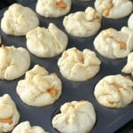 These Pumpkin Cheesecake Puffs are such a light and yummy pumpkin dessert perfect in the Fall! Plus, they are easy and fast to make! The filling is awesome on toast too! From www.overthebigmoon.com!