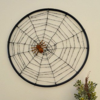 Hula Hoop Spiderweb - this is such an affordable and easy DIY Halloween craft! Full tutorial on www.overthebigmoon.com!