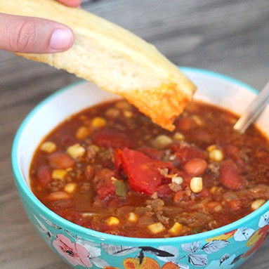 Mexican Taco Soup that is so filling and tasty! Super easy to prepare too! Perfect for a cold day! From www.overthebigmoon.com!