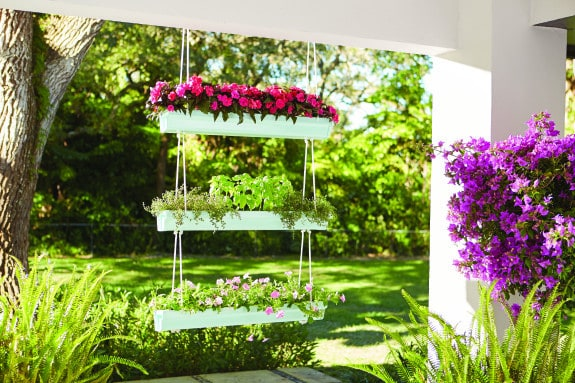 Hanging Gutter Planter - such a fan and inexpensive project that even a beginner can make!   www.overthebigmoon.com