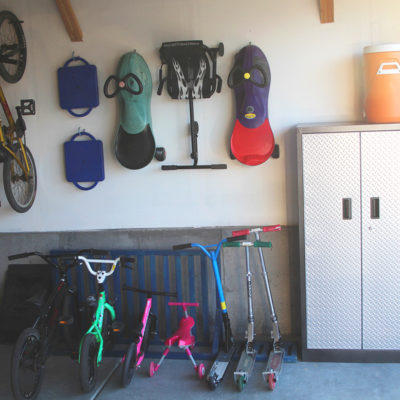 Creating a kids garage area will totally save your garage and your sanity! Now your kids will know where everything is! From www.overthebigmoon.com!