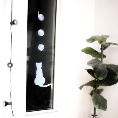 These DIY halloween window clings are so simple and minimal. They're perfect for any home's halloween decor and all you need is your Cricut!