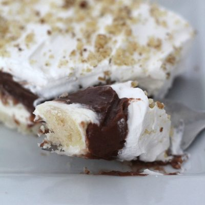 This Nutty Torte Layered Dessert is one of my ALL TIME FAVORITE desserts! | www.overthebigmoon.com