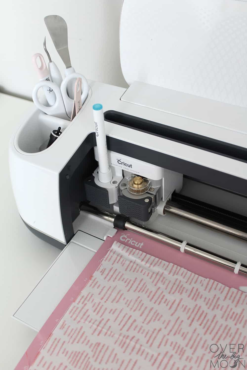 The Cricut Maker can making sewing 10x easier by cutting the fabric for you! Come see these Soft Baby Blocks! From www.overthebigmoon.com