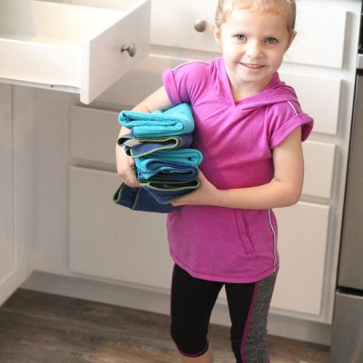Getting kids involved in helping with the laundry is a game changer! Come check out the Best Laundry System for Families! From overthebigmoon.com! #laundry #chores