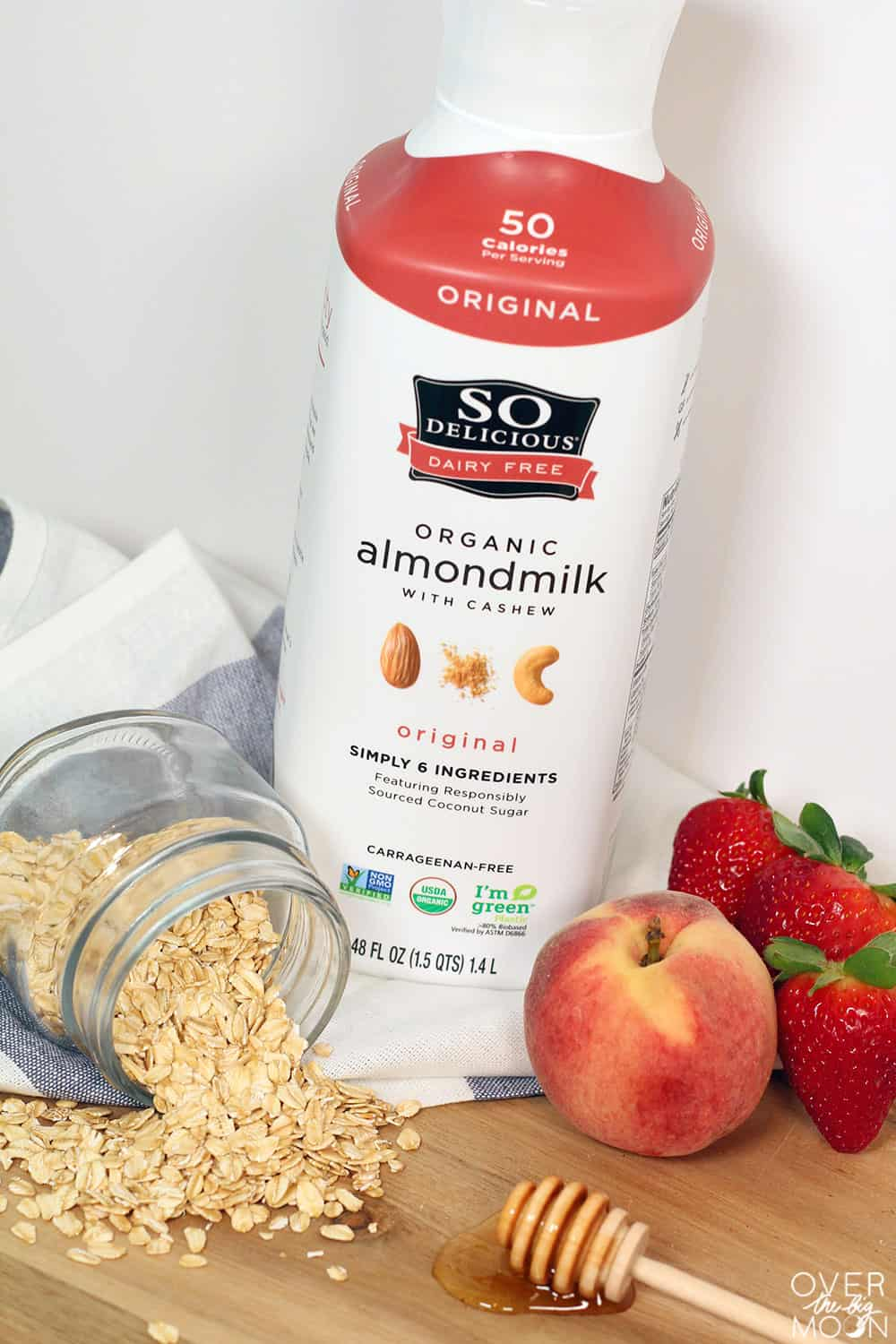 Overnight Oats recipe - Strawberry Peach Honey flavored using SoDelicious Almond Milk! From overthebigmoon.com! #overnightoats #almondmilk #breakfastrecipe