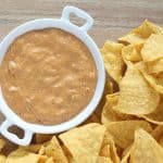 This Warm Chili Cheese Queso is a favorite of ours! Perfect for parties, potlucks and BBQ's! From overthebigmoon.com!