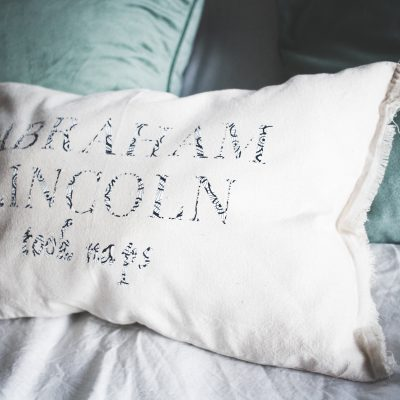 Cricut's new patterned iron on looks fantastic as text and shapes! I made a decorative pillow out of drawstring bags and love how it turned out.