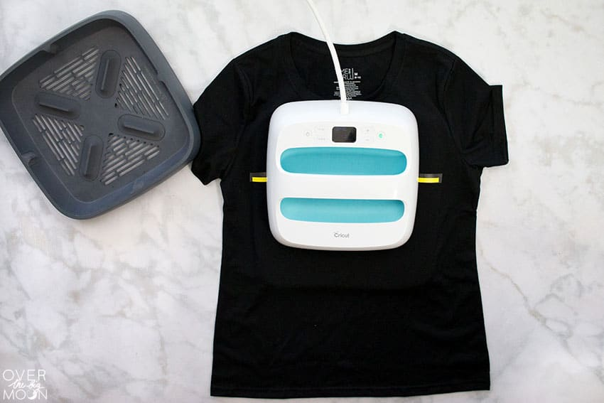 Using the EasyPress to apply Iron On to a t-shirt for a Teacher Netflix and Grade t-shirt! From overthebigmoon.com!