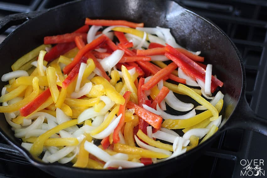 Peppers getting ready to cook in a Cast Iron Skillet to make Fajitas! From overthebigmoon.com!