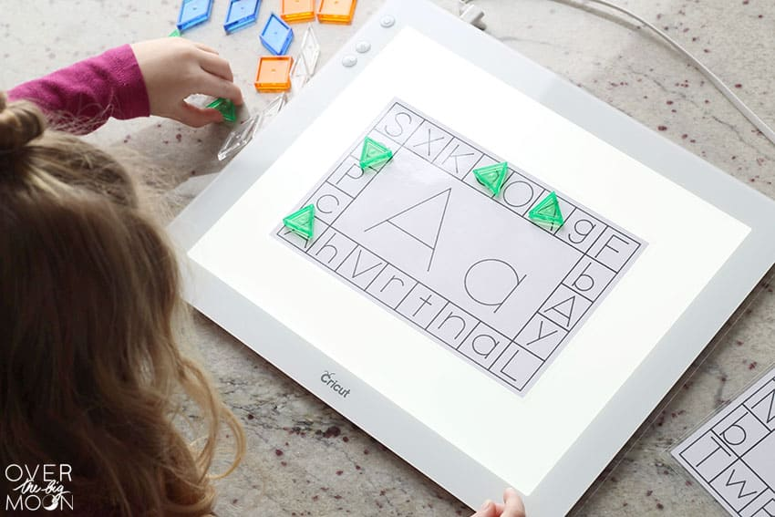 Preschooler playing with the letter A Learning Card on the BrightPad.