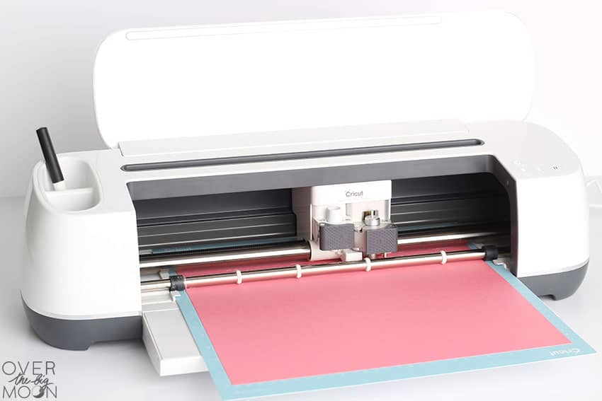 The Cricut Maker writing and cutting the invitation!